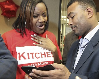 William d Lewis The Vindicator  DeMaine Kitchen checks election results as his wife Leslie Kitchen reacts to the results during election night party in downtown Youngstown. HE LOST.