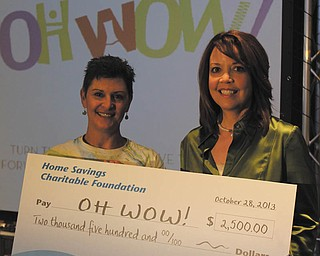 SPECIAL TO THE VINDICATOR Home Savings Charitable Foundation has donated $5,000 to OH WOW! The Roger & Gloria Jones Children's Center for Science & Technology. Above are Suzanne Barbati, left, executive director of OH WOW!, and Trish Mohan, branch manager of Home Savings Main Office. For information about OH WOW! call 330-744-5914 or visit www.ohwowkids.org/.