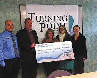 SPECIAL TO THE VINDICATOR Home Savings Charitable Foundation recently donated $5,000 to Turning Point Counseling Services. The funds will be used for the transition to an electronic health-care records system. From left are Andrew Nemergut, personal banker, Home Savings Liberty office; Joseph A. Sylvester, executive director, Turning Point; Kim Gennaro, branch manager, Home Savings Liberty office; and Jessica Sprowl and Virginia Phillips, development specialists at Turning Point.