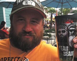 """Leslie Meehan: """"My husband Carl Meehan loves his beard! He started growing it after Christmas last year. The picture is from our vacation to Florida in June, and, of course, he is carrying his """"Fear the Beard"""" cup of sweet tea!"""