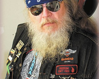 """Hairy George Nitzsky of Youngstown has had this beard long enough to be known as Hairy George all of his adult life. He says, """"My beard and my hair keep me warm while I ride."""" Submitted by Patricia Ott."""