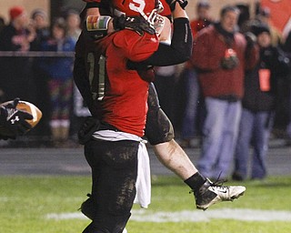 ROBERT K. YOSAY  | THE VINDICATOR..Struthers #34  Jay King jumps into Luke Witkowski arms after Luke ran the TD that put struthers ahead in the third quarter and they never looked back... - -30-.......