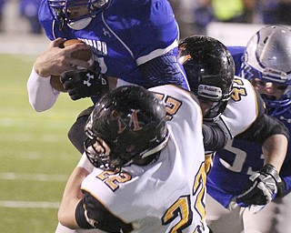 william D. Lewis | The Vindicator .Hubbard's Brennan Wassil (7) is stopped by Marlington's Tyler Tokos(22) during 1rst half playoff action at Hubbard 11082013.