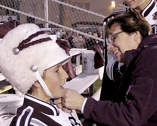 William D LEwis the vindicator Beth Bean, Boardman Band Booster President helps kaitlin Windt with her band hat before halftime show.