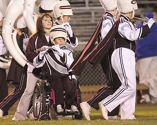 William D LEwis The Vindicator Boardman band member Kaitlin Windt, in wheelchair,  gets help from Rachel Ruggieri during 11012013 halftime show.
