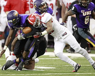 Northern Iowa quarterback Brion Carnes is tackled by tackled by Youngstown State's Dale Peterman in the second half of the game at the UNI-Dome in Cedar Falls, Iowa, Saturday, Nov. 9, 2013.