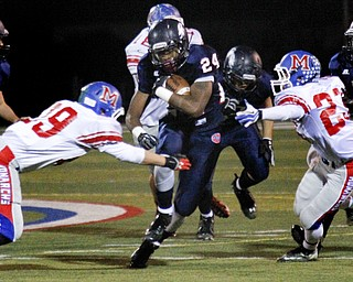 MADELYN P. HASTINGS | THE VINDICATOR..Fitch's Darrin Hall (24) runs with the ball while Marysville's Ty Stiers (29) and Sam Tse (23) try to tackle him during their game on November 9, 2013.... - -30-..