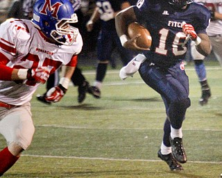 MADELYN P. HASTINGS | THE VINDICATOR..Fitch's Antwan Harris (18) runs with the ball while Marysville's Kenny Kinder (27) attempts to stop him during their game on November 9, 2013.... - -30-..