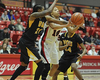 Youngstown State #14 Karen Flagg attempts to pass the ball while VCU #24 Robyn Parks and #34 Keira Roberts pressure her burring the pass.