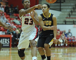 Youngstown State #23 Melissa Thompson passes the ball to a tam mete to avoid the pressure from VCU defender #21 Ashlee Mitchell during the first half of Saturday afternoons game.
