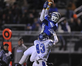 Reserve #11 Joe Falasca jumps up to catch a pass overTrinity defensive back #83 Jacob Walters with seconds left in the first had to move reserve into field goal range during Saturday nights game.
