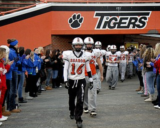 MADELYN P. HASTINGS | THE VINDICATOR..The Sharon High School football team walks out onto the field from their locker room with support from family and friends before their first football practice since the fatal car accident Friday night, killing two of their teammates. Their playoff game was rescheduled for Monday.... - -30-..