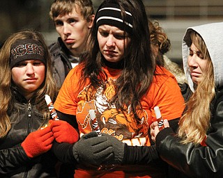MADELYN P. HASTINGS | THE VINDICATOR..(L-R) Sharon High School students Jenna Wagner, Samantha Lait, and Kayla Reardon mourn the loss of football players Corey Swartz and Evan Gill during a candle light vigil at the stadium on November 10, 2013. ... - -30-..