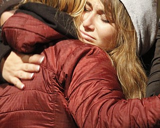 MADELYN P. HASTINGS | THE VINDICATOR..Kayla Reardon hugs a loved one during a candle light vigil held at the Sharon High School stadium on November 10 mourning the deaths of a fatal car accident occurring November 8.... - -30-..