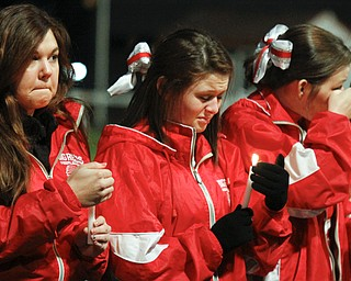 MADELYN P. HASTINGS | THE VINDICATOR..The Sharon High School cheerleaders mourn the loss of football players Corey Swartz and Evan Gill during a candle light vigil at the stadium on November 10, 2013. ... - -30-..