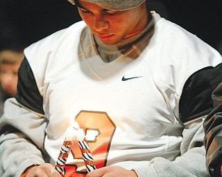 Sharon football player Troy Hejazi mourns teammates Corey Swartz and Evan Gill during a vigil Sunday at the stadium.