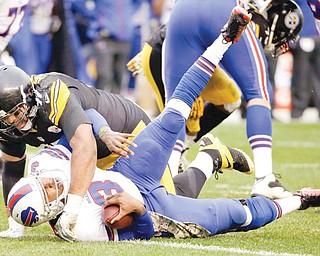 The Steelers' Cameron Heyward sacks Bills quarterback EJ Manuel during Sunday's game in Pittsburgh. The Steelers took down the Bills, 23-10.