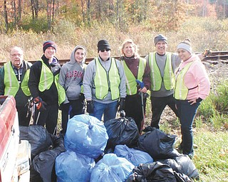 SPECIAL TO THE VINDICATOR Boardman Lions Club joined forces with Boardman High School National Honor Society members and cleaned a stretch of the roadside along Southern Boulevard between Western Reserve Road and Route 224. They collected 42 bags of trash and six bags of recyclable materials, including a $5 bill, while working in conjunction with the County Engineer's Office and the Green Team. Above, from left, are John Landers, Lions Club member; Rudy Tepsick, Dante DeLullo and Tommy Sodeman, NHS members; Joni Blase and Terry Shears, Lions Club members; and Alex Gordon, NHS member. King Lion Ron Paris also participated in the cleanup.