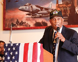 Jordan J. Corbett of Florida, one of three living members of the Army's historic 555th Parachute Infantry Battalion, the first all-black paratrooper unit in the military, talks about his experiences at Monday's VFW Post 6488 and Ladies Auxiliary Veterans Day program.