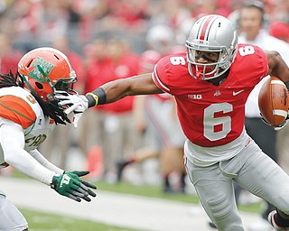 Ohio State wide receiver Evan Spencer (6) avoids a Florida A&M defender during a game in Columbus. Ohio State might be No. 3 in the polls, but Spencer thinks the Buckeyes are better than No. 1 Alabama and No. 2 Florida State.