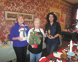 SPECIAL TO THE VINDICATOR Darlene Bennett, left, Susan Stoddart and Susan Pappas are displaying some of the items that will be for sale at the Upton Association holiday garage sale from 9 a.m. to 4 p.m. Friday and Saturday. Donations can be dropped off from 9 a.m. to noon Thursday at Upton House, 380 Mahoning Ave., Warren. Proceeds will be used to maintain the home. For public or private rentals call 330-395-1840.