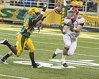 Youngstown State receiver Nate Adams catches a pass in last year's 48-7 loss to North Dakota State. The Penguins are hoping for a better result on Saturday when they play at Stambaugh Stadium.