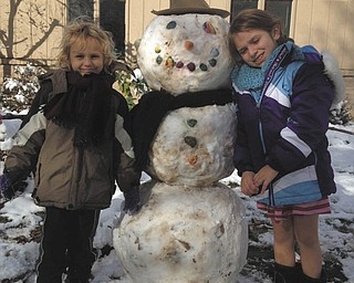 SPECIAL TO THE VINDICATOR Joey Lettieri, 5, and Isabella Lettieri, 9, of Cape Hatteras, in the Outer Banks of North Carolina, were visiting Grandma Joanne Shutrump in Boardman this week when they got a blast of Northeast Ohio winter weather. Of course, the kids' very first snowman had to be a work of art, right down to the hat and scarf that give him a distinctly cool fashion air. In the spirit of the best of both worlds, the flaky character they dubbed Chester has a face made with seashells from the seashore. The children's parents are Maryjill (Shutrump) and John Lettieri.