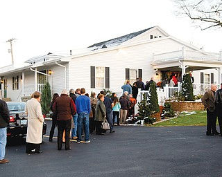 Friends of John Zdelar line up out the door at the Lane Madasz Funeral Home in Brookfield Township on Wednesday. He was among three who died in a car accident Friday night in Sharon.