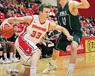 Youngstown State's Ryan Weber drives around Warren Wilson's Tyler Triplett during the Penguins' home opener Thursday at YSU's Beeghly Center. YSU downed the Owls, 104-58, to remain undefeated at 4-0.