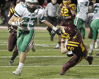 .          ROBERT  K. YOSAY | THE VINDICATOR..Mogadore #23 Dominik (ok) Pizzino. puts a stiff arm to #10 SR  Greg Dunham as he scampers for a first half  first down..South Range and Mogadore in Minerva Ohio .....-30-