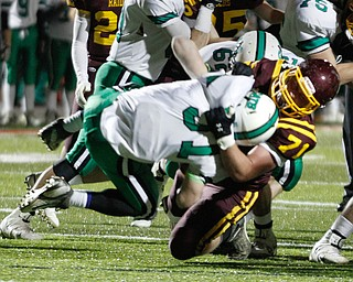 .          ROBERT  K. YOSAY | THE VINDICATOR..BIG HIT at the line as SR  #71  Ben Farmer  Wraps up and tackles Mogadore  #31  Brandon Berry at the line during first quarter action..South Range and Mogadore in Minerva Ohio .....-30-
