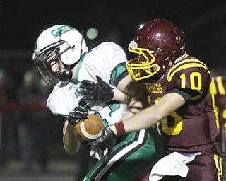 .          ROBERT  K. YOSAY | THE VINDICATOR..SR #10  Greg Dunham does his best to break up a pass play to Mogadore #11 Josh Morgan during second quarter action -  first down by Mogadore...South Range and Mogadore in Minerva Ohio .....-30-