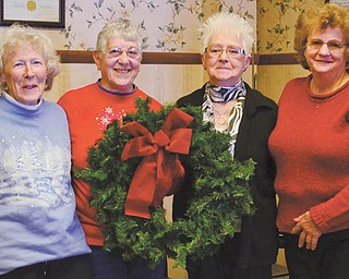 NANCY URCHAK | THE VINDICATOR Friends of the Children's Aid Society are planning a Christmas fundraiser from 11 a.m. to 4 p.m. Dec. 5 and 6 at the society, 350 W. Market St., Mercer, Pa. Advance orders of poinsettias, fresh evergreen wreaths, swags and white pine roping will be accepted until Nov. 27 and picked up on those two dates. Also available those days will be baked goods. All proceeds benefit the Children's Aid Society. From left, above, Julie Amhalt; Kate Snyder, recording secretary; Julia Adams, CAS staffer; and Carol Smith, president, prepare for the event. For information call 724-981-0591 or 724-662-4730.