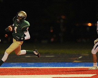 St. Vincent - St. Mary #4 Jarel Woolridge sprints to the end zone to score a touchdown beating Poland #11 Dylan Garver on a reverse on the first series of the game during Friday nights game in Ravenna.