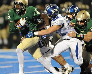 St. Vincent - St. Mary #21 Parris Campbell Jr. runs away from Poland #23 Adam Wollet and #12 Tyler Smith during Friday nights game in Ravenna.