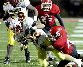 William D Lewis The Vindicator Mooney's Mark Handel(22) is stopped by Struthers Nick Pollifrone(21) in background is wildcat Derrick Reber(53) during playoff action Friday in Niles.