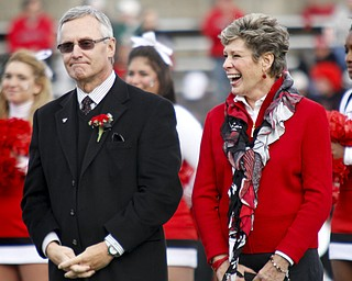 MADELYN P. HASTINGS | THE VINDICATOR..Ellen Tressel smiles with her husband Jim after being inducted into YSU's Hall of Fame at half time of the YSU vs. NDSU game at Stambaugh Stadium on November 16, 2013.... - -30-..