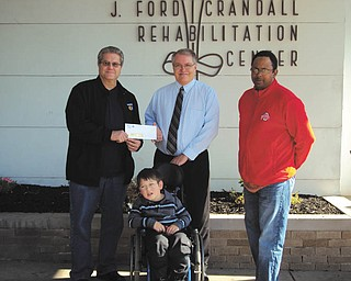 SPECIAL TO THE VINDICATOR Members of United Automobile, Aerospace and Agricultural Implement Workers of America Local 1112 Education Committee recently presented Easter Seals of Mahoning, Trumbull and Columbiana counties with a check for $2,000 to assist those with disabilities and special needs. Above, from left, are Tim O'Hara, vice president of UAW Local 1112; Larry Smith, Easter Seals child representative; Kenan Sklenar, president and CEO of Easter Seals; and Russ Pinkard, chairman of UAW Local 1112 Education Committee.