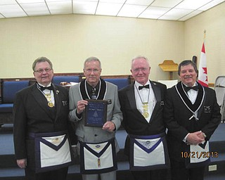 SPECIAL TO THE VINDICATOR Niles McKinley Lodge 794 presented the Master Mason of the Year Award on Oct. 21 to two-time Past Master Thomas A. Redmond Sr. Redmond has been a Mason for 18 years and holds the post of trustee, who sits in for an officer who can't make a meeting. Attending the award presentation were, from left, Charles Chagnot, district deputy grand master; Redmond; Adrian McAleer, district deputy grand master; and John Schuster, worshipful master of Lodge 794.