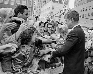 President John F. Kennedy is greeted by an enthusiastic crowd in front of the Hotel Texas in Fort Worth,  Nov. 22, 1963.