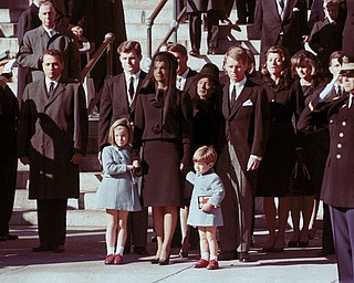 The First Family watches John F. Kennedy's funeral procession in Washington on Nov. 25, 1963, three days after the president was assassinated in Dallas. Widow Jacqueline Kennedy, center, daughter Caroline Kennedy, left, and son John Jr., are accompanied by the late president's brothers Sen. Edward Kennedy, left, and Attorney General Robert Kennedy.