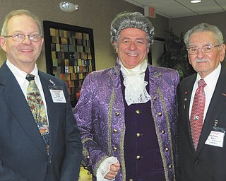 """SPECIAL TO THE VINDICATOR William E. Johnson, dressed as the Colonial patriot John Hancock, stands between retired Lt. Col. Rod Hosler of Boardman, left, and retired Maj. Peter Mihai of Youngstown. At a recent meeting of the Mahoning and Shenango Valleys Chapter of the Military Officers Association of America, Johnson was the guest speaker. He offered a glimpse of colonial history in Hancock's persona. An actor in the stage play """"1776,"""" Johnson also has written two fictional historical books about colonial days: """"Snug Harbor Tavern"""" and """"Seeds of Love — and War."""" A former Navy aviator, Johnson lives in Youngstown and gives seminars nationwide. The next MSVC-MOAA meeting will take place jointly with the Mahoning Valley Chapter of the Reserve Officers Association Dec.8 at the Manor Restaurant, at the corner of state Route 46 and Kirk Road in Austintown. For reservations call 330-568-4456."""