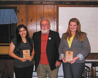 SPECIAL TO THE VINDICATOR The Columbiana Rotary Club presented youth awards for 2013 during its annual dinner Nov. 5. Students are selected on the basis of scholarship, character and service and were presented with plaques. From left are recipient Pam Baer, 4-H member; presenter Terry McCoy, Rotarian; and recipient Carlie Merlo, Interact Club.
