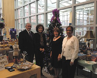 SPECIAL TO THE VINDICATOR Members of An American Holiday preview party committee meet in the gift shop of the Butler Institute of American Art, near the volunteers tree. From left to right are Anthony Monaco, Florence Wang and docents Cynthia Perantoni Anderson, chairwoman; and JoAnn Blunt. Ornaments on the tree were designed by Butler gift shop volunteers.