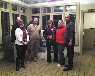 SPECIAL TO THE VINDICATOR The Poland Rotary with Poland Junior Women's League have been preparing luminaries for the Lighting of the Village at 4 p.m. Dec. 7. Above, from left, are Holly Fritz, Dan Madden, Chris Cruciger, Maryann Carano, Shellie Duchek and Brandon Davis. The luminaries will be lighted along Route 170 from Poland Town Hall to Peterson Park. The lighting of the village tree, free and open to the public, will take place at 5:30 p.m. featuring carols, cookies and cocoa, horse-drawn carriage rides and Santa's arrival. Children will have an opportunity to talk to Santa. Make donations payable to Poland Junior Women's Club, in care of Carolyn Fender, 8651 Hilltop Drive, Poland, OH 44514. For information or to volunteer call 330-716-1705.