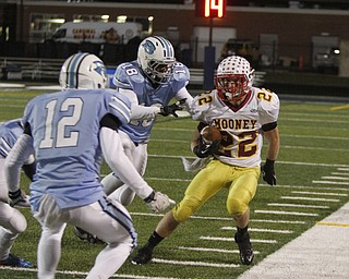 .          ROBERT  K. YOSAY | THE VINDICATOR..No where to go as Mooneys Mark Handel gets surrounded after he made the first down by #12 Dom Berdysz and  #18 Davell Moore-Meeks of Benedictine..Cardinal Mooney Cardinals vs Cleveland Benedictine Bengals in Solon.....-30-