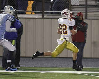 .          ROBERT  K. YOSAY | THE VINDICATOR..Foot race to the EndZone as Mooney #22 Mark Handel breaks free for a 60+ yard TD Run and he start of a mooney first half that saw 28 points - in the chase is  @@ Benedictine Matt Merimee (first quarter action)..Cardinal Mooney Cardinals vs Cleveland Benedictine Bengals in Solon.....-30-