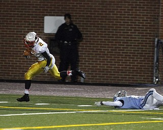 .          ROBERT  K. YOSAY | THE VINDICATOR..Mooneys #2 C J Amil breaks the last tackle of  Dom Berdysz  for Benedictine as he goes in for 6 after a 40 + yard run and a TDCardinal Mooney Cardinals vs Cleveland Benedictine Bengals in Solon.....-30-