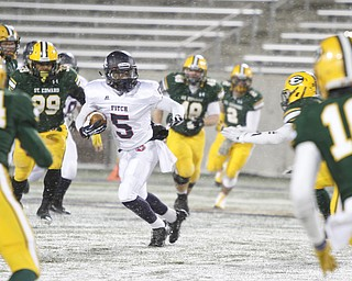 .          ROBERT  K. YOSAY | THE VINDICATOR..Fitchs #5 Andrew Dowell  looks for a place to run as he is surrounded by  St Eds #14 Matt Carandang  Max Williams  (99) #26 (hidden) Kyle Hefedus and #18  David Dowell.. Austintown Fitch and St Edwards at Infocision in Akron.....-30-