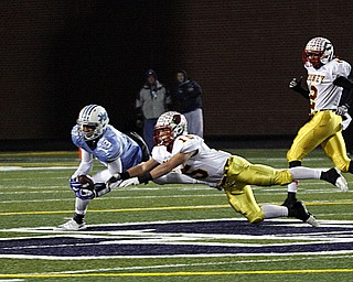 .          ROBERT  K. YOSAY | THE VINDICATOR..Almost breaking up the pass Mooneys #15 Denver Martin as he reaches for #13 Justin Layne for Benedictine who made the catch.First quarter Action.Cardinal Mooney Cardinals vs Cleveland Benedictine Bengals in Solon.....-30-